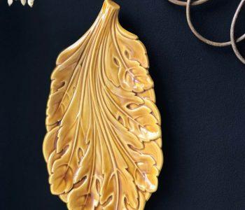 blad kaasplank geel